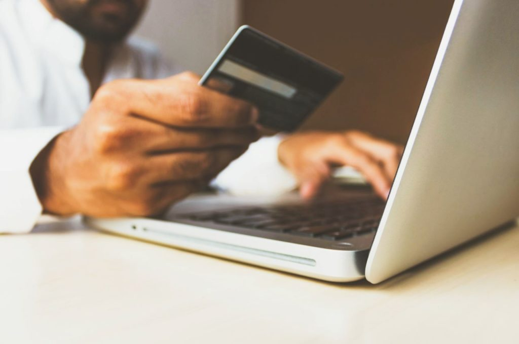 man paying tax bill online